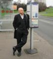 Patrick at bus stop (13337968505).png