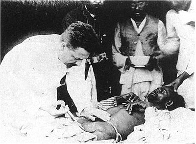 Paul-Louis Simond injecting a plague vaccine in Karachi, 1898. Paul-Louis Simond injecting plague vaccine June 4th 1898 Karachi.jpg
