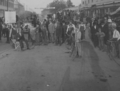 Paying a political bet, Nels Hultberg gives Claude Shafer a wheelbarrow ride down Main Street, circa 1910.png