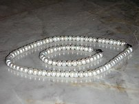 Author's own picture. Pearl necklace and bracelet.
