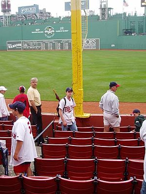 Pesky's Pole - The bottom portion of Pesky's Pole, with the Green Monster in the background and Fenway Park's right field seats in the foreground.