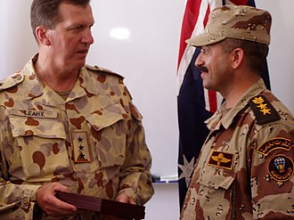Peter Leahy - Leahy, left, presents an award to Iraqi Colonel Mohammed Fa'ek Raouf in July 2005. U.S. Army photo