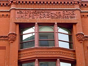 J.H.C. Petersen's Sons' Store - Facade detail over the main entry.