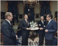Photograph of the Four Presidents (Reagan, Carter, Ford, Nixon) in the Blue Room prior to leaving for Egypt and... - NARA - 198523.tif