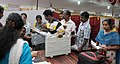 Polling officials collecting the Electronic Voting Machines (EVM) and other necessary inputs required for the Kerala Assembly Election, at the distribution centre, in Nemom, Thiruvananthapuram on May 15, 2016.jpg