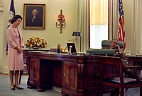 Lyndon Baines Johnson seated at the Johnson desk, 1968.