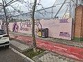 Primer plano mensaje mural Polideportivo Municipal la Concepción.jpg