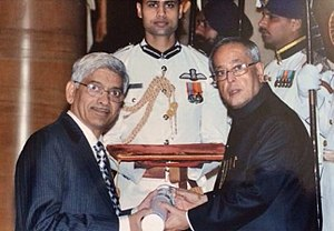 Ramakrishna V. Hosur - Professor Hosur receiving the Padma Shri Award from President of India Pranab Mukherjee in 2014