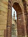 Qutub minar as seen from the arches.jpg