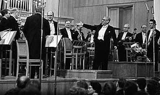 Henri Sauguet - Henri Sauguet (fourth right), with Mstislav Rostropovich (fourth left), in the Grand Hall of the Moscow Conservatory, 1964.