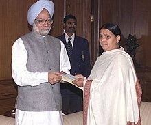 Rabri Devi presenting a cheque for Rs. 10 crore on behalf of the State Government to the Prime Minister, Dr. Manmohan Singh for the Prime Minister's National Relief Fund, in New Delhi on January 04, 2005.jpg
