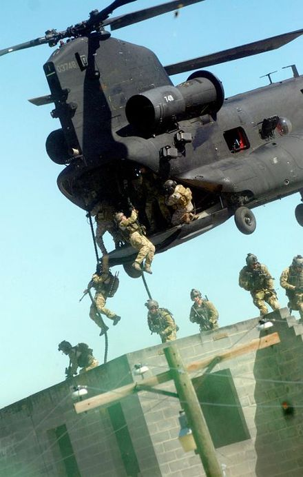 Rangers practice fast roping techniques from an MH-47 during an exercise at Fort Bragg Rangers from the 75th Ranger Regiment fast-rope from an MH-47 Chinook during a capabilities exercise.jpg