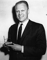 Representative Gerald R. Ford, Jr. with his Sports Illustrated Silver Anniversary Award - NARA - 7064481.jpg
