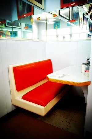 A two-person booth in a restaurant.