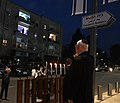 Reuven Rivlin lights the fourth Hanukkah candle with his neighbors, December 2020 (GPOMN1 2668).jpg