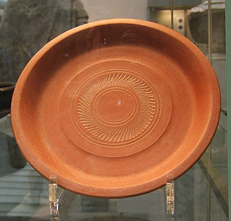 Ancient Roman pottery - A typical plain African Red Slip dish with simple rouletted decoration. 4th century AD.