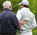 Rory McIlroy and father (facing away).jpg