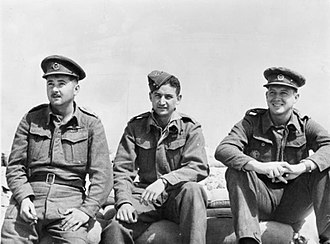 "Desert Air Force - March/April 1942, Landing Ground 121, Egypt. Lieutenant Robin Pare (left), Major John ""Jack"" Frost (centre) and Captain Andrew Duncan (right) of 5 Squadron SAAF, Desert Air Force. All three had been killed or were missing in action by the end of June. Frost, the squadron commander, was the highest scoring ace in an SAAF unit during World War II."