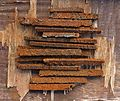 Rusty scraps of iron on a weatherworn plywood table.jpg