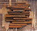 Rusty scraps of iron on a weatherworn plywood table.jpg