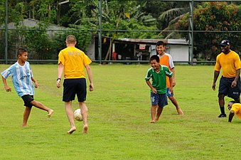 Sailors and Marines play football with children in Thailand 110504-N-IC111-580.jpg