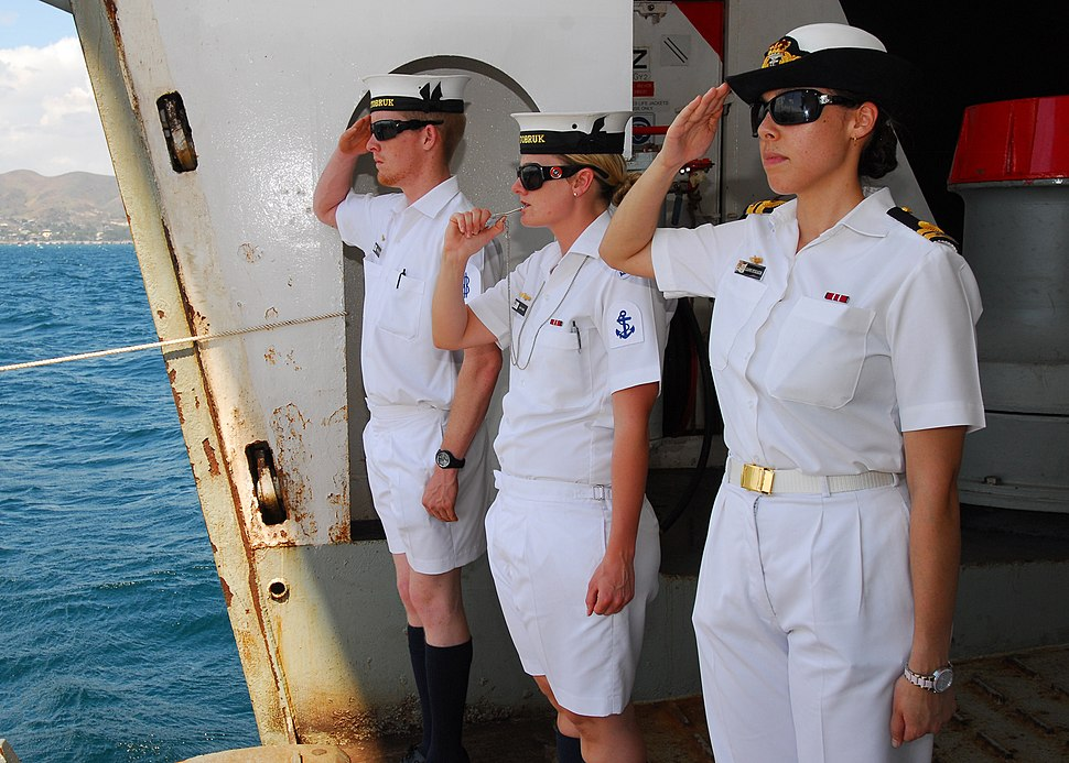 Sailors render honors as distinguished visitors depart HMAS Tobruk