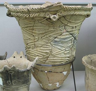 """Sannai-Maruyama site - Ento style pottery recovered from Sannai Maruyama. The word """"Ento"""" means """"cylindrical"""". This vessel is a long structure with a wide orifice at the top, and ornamental details. Ento vessels were commonly decorated with cord marks."""