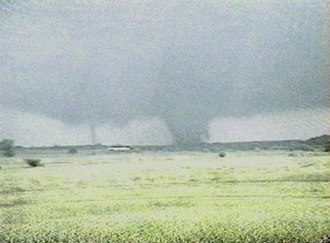 Satellite tornado - A tornado with an associated satellite tornado. The large tornado on the right is the 1999 Bridge Creek – Moore tornado and the small tornado to the left is a satellite tornado.