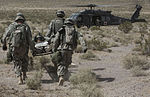 Soldiers engage enemy targets with howitzer and save the wounded 140517-A-QU939-752.jpg