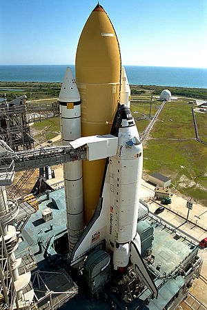 Space Shuttle Discovery sits atop a mobile lau...