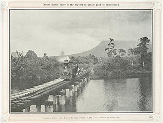 Russell River (Queensland) - Small steam train crossing the Russell River with Mount Bartle Frere looming in the background, circa 1924