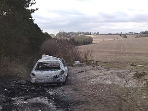 English: Stolen car burnt out deep in the coun...