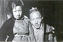 Surkhang Dsaza with his young son.jpg