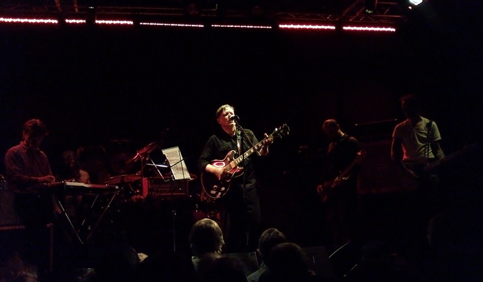 The re-formed Swans performing in Tallinn in May 2011. From left to right: Thor Harris, Christoph Hahn, Phil Puleo (behind drum set), Gira, Chris Pravdica and Norman Westberg. Swans live.png