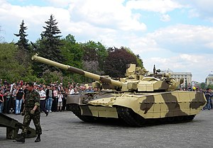T-84 - BM Oplot guided onto a tank transporter.