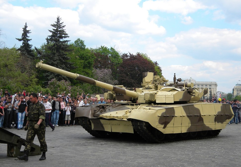 T-84 Oplat guided onto a tank transporter