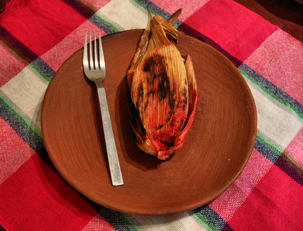 A tamal dulce breakfast tamal from Oaxaca, Mexico. It contains pineapple, raisins and blackberries. Tamal de zarzamoras.png