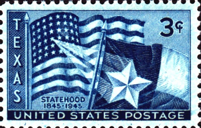 First class postage stamp showing U.S. and Texas flags together, issued for the Texas Statehood Centennial, in 1945. Yes, first class postage was three cents. Wikipedia image.