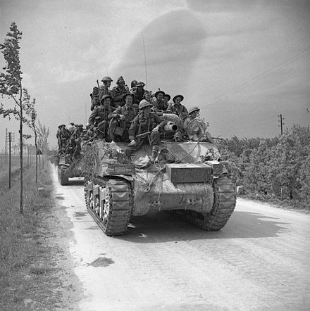 Men of the 2nd Battalion, Lancashire Fusiliers riding a Sherman tank into battle during the final Italian offensive, April 1945. The British Army in Italy 1945 NA24365.jpg