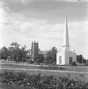 Siege of Bangalore - Memorial Obelisk raised for the British and Indian Officers and Men who fell in the Siege of Bangalore, 1791. The Hudson Memorial Church can be seen in the background. (The memorial was vandalised on 28 October 1964)