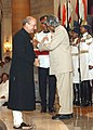 The President Dr. A.P.J Abdul Kalam presenting Padma Shri Award to Shri Anupam Pushkarnath Kher the well-known film and theatre personality at an investiture Ceremony at Rashtrapati Bhawan in New Delhi on June 30, 2004.jpg