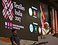 The Prime Minister, Shri Narendra Modi addressing the gathering at the inauguration ceremony of the Textiles India 2017, in Gandhinagar, Gujarat on June 30, 2017 (1).jpg