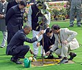 The US President, Mr. Barack Obama planting a sapling, at Rajghat, in Delhi on January 25, 2015. The Minister of State (Independent Charge) for Power, Coal and New and Renewable Energy, Shri Piyush Goyal is also seen.jpg