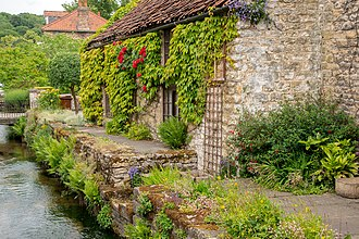 A traditional cottage by the stream Thornton cottage w 9687.jpg