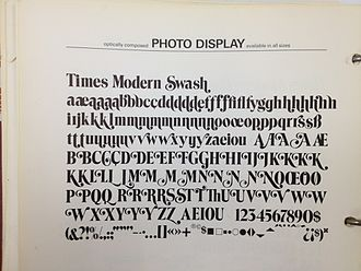 Times New Roman - Times Modern Swash, an exaggerated and unauthorised display adaptation of Times from the phototypesetting period.