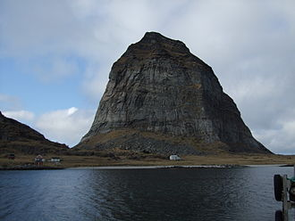 Strandflat - The mountain Trænstaven in Træna commune is a rauk amidst the strandflat of Norway's coast.