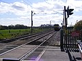 Train approaching Mill lane Level Crossing - geograph.org.uk - 1242772.jpg