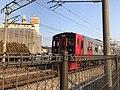 Train for Fukuma Station near Kyusandai-mae Station.jpg