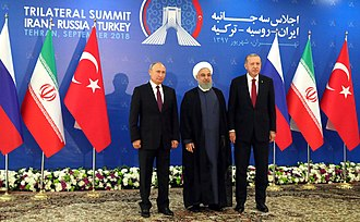 Putin with Iranian President Hassan Rouhani and Turkish President Recep Tayyip Erdogan, September 2018 Trilateral Iran-Russia-Turkey Summit September 2018 in Tehran 4.jpg