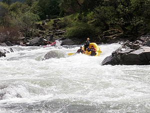 South Fork American River - A raft and an inflatable kayak maneuver through Troublemaker rapid in Coloma California